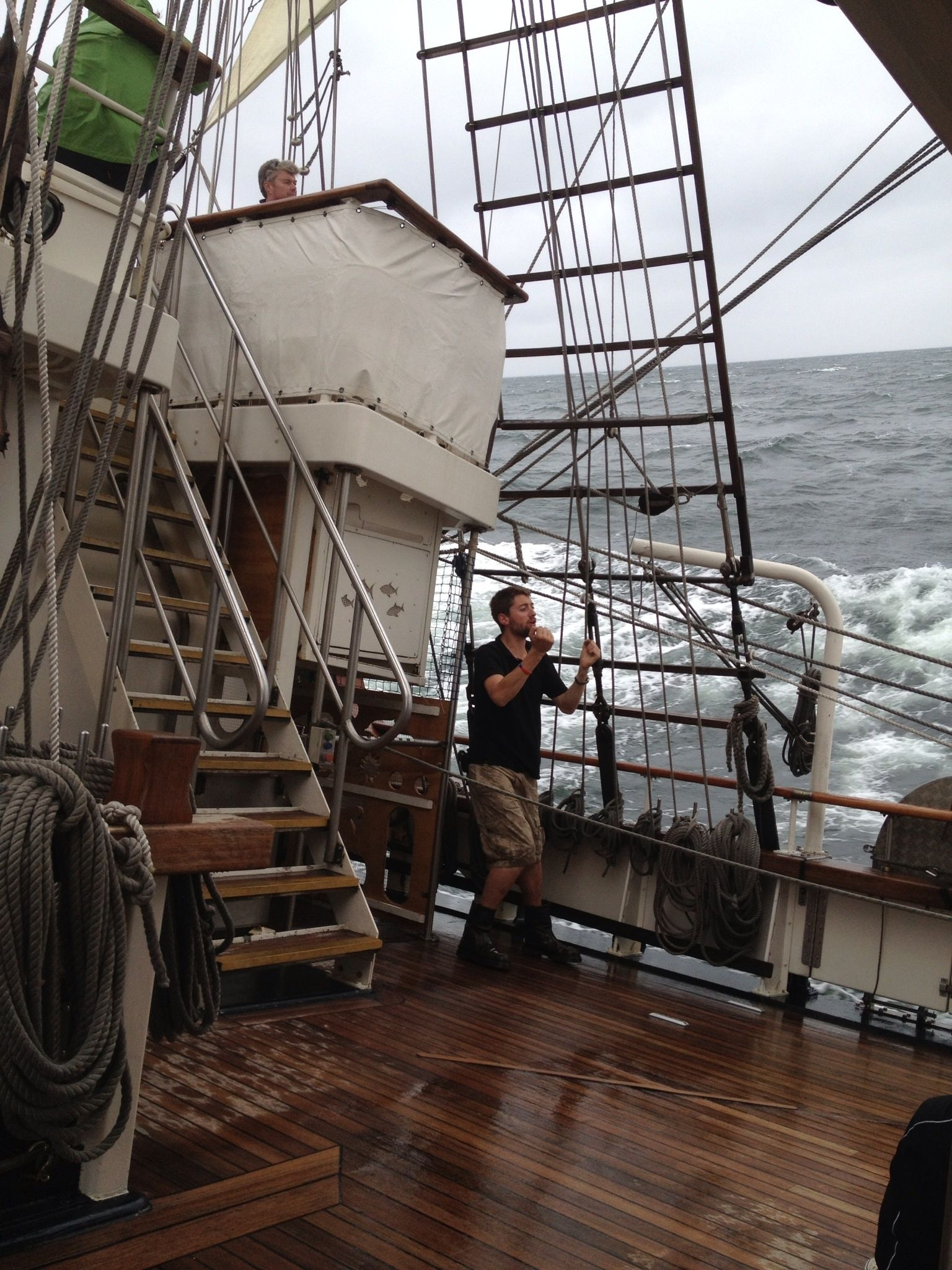 SV Tenacious under rough weather, drenching the Bosun. Tall Ships Races 2013