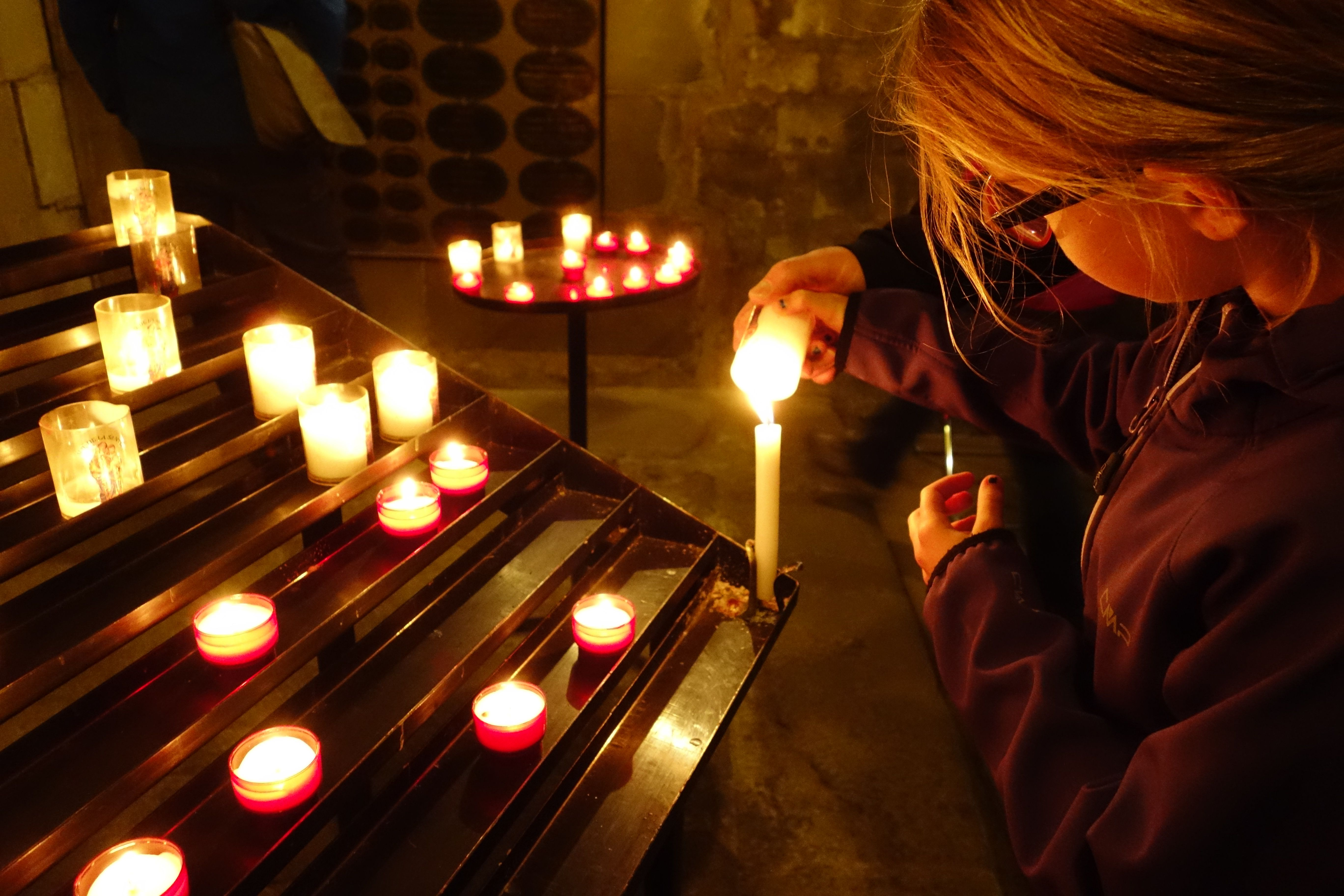 Girl lights Candle at Saint-Nazaire, Carcassonne