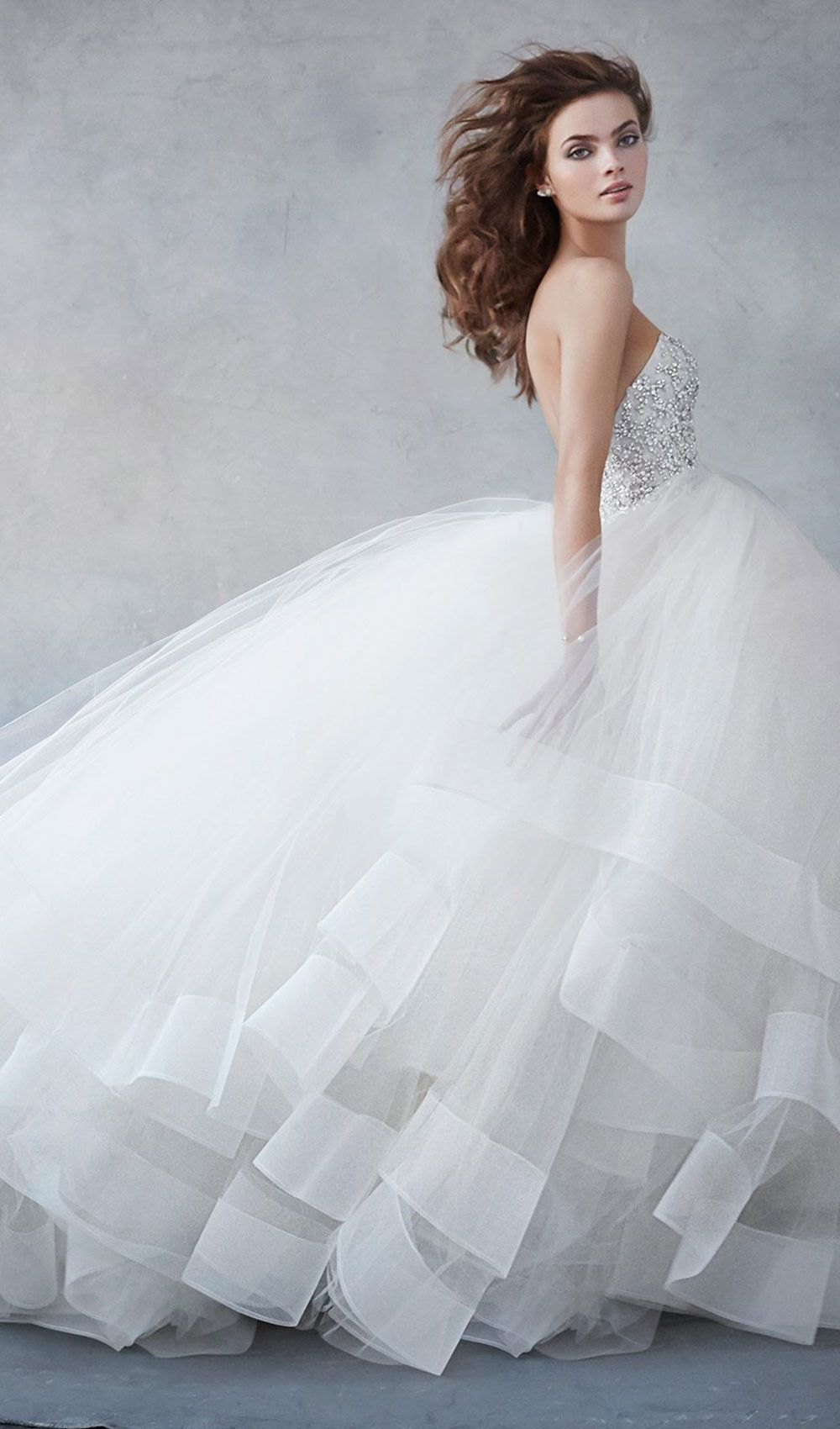 Stun guests with this champagne tulle bridal ball gown from Lazaro! The pearl and rhinestone encrusted bodice is too gorgeous for words. Available at Schaffer's in Des Moines.   Wedding Dress Info: Lazaro - STYLE 3608