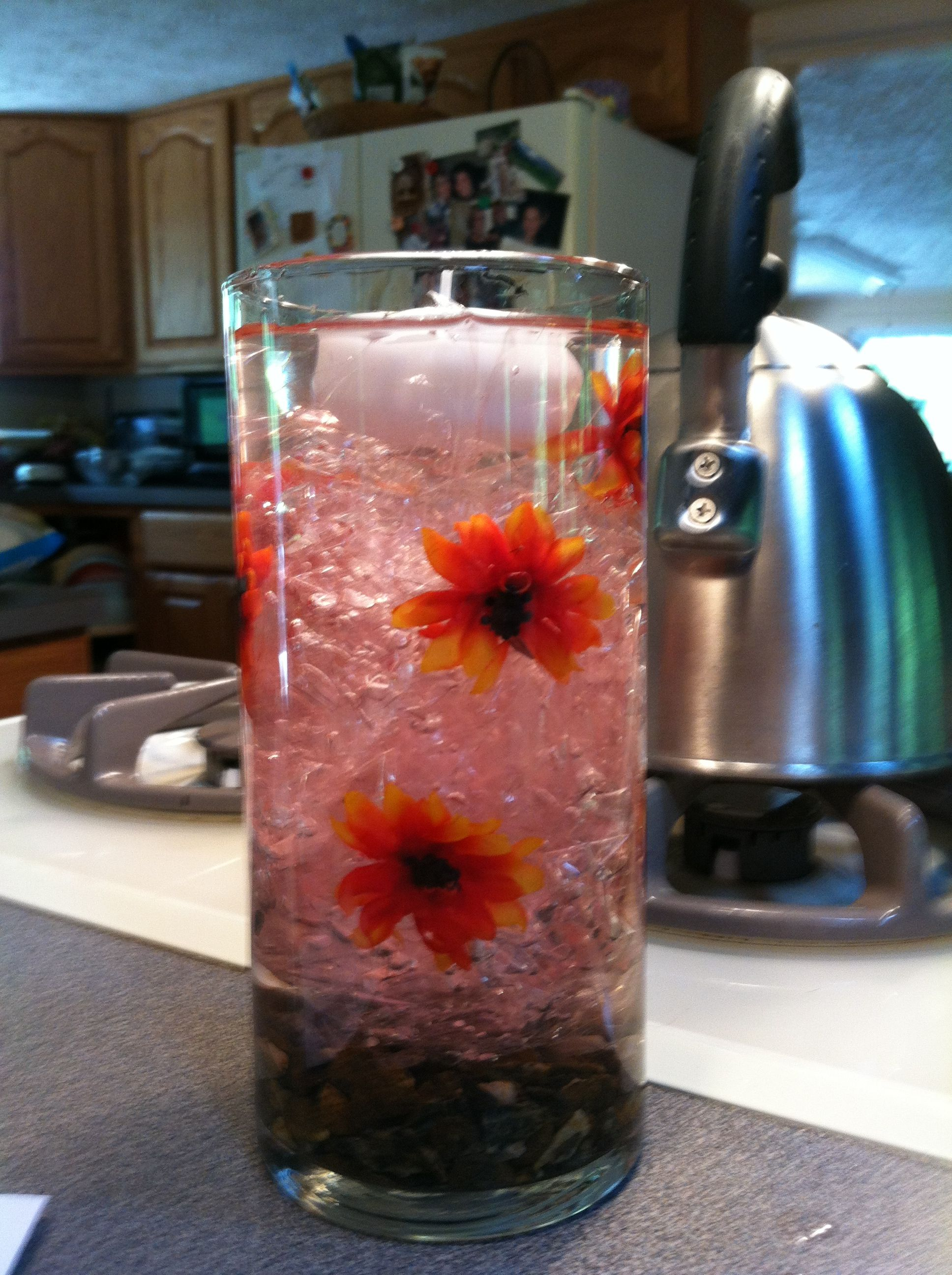 simple and easy centerpiece cellophane rocks fake flowers cut