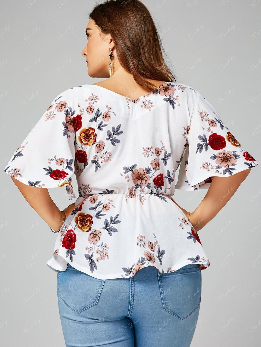 eac686695094b Floral Plus Size Belted Surplice Peplum Blouse -