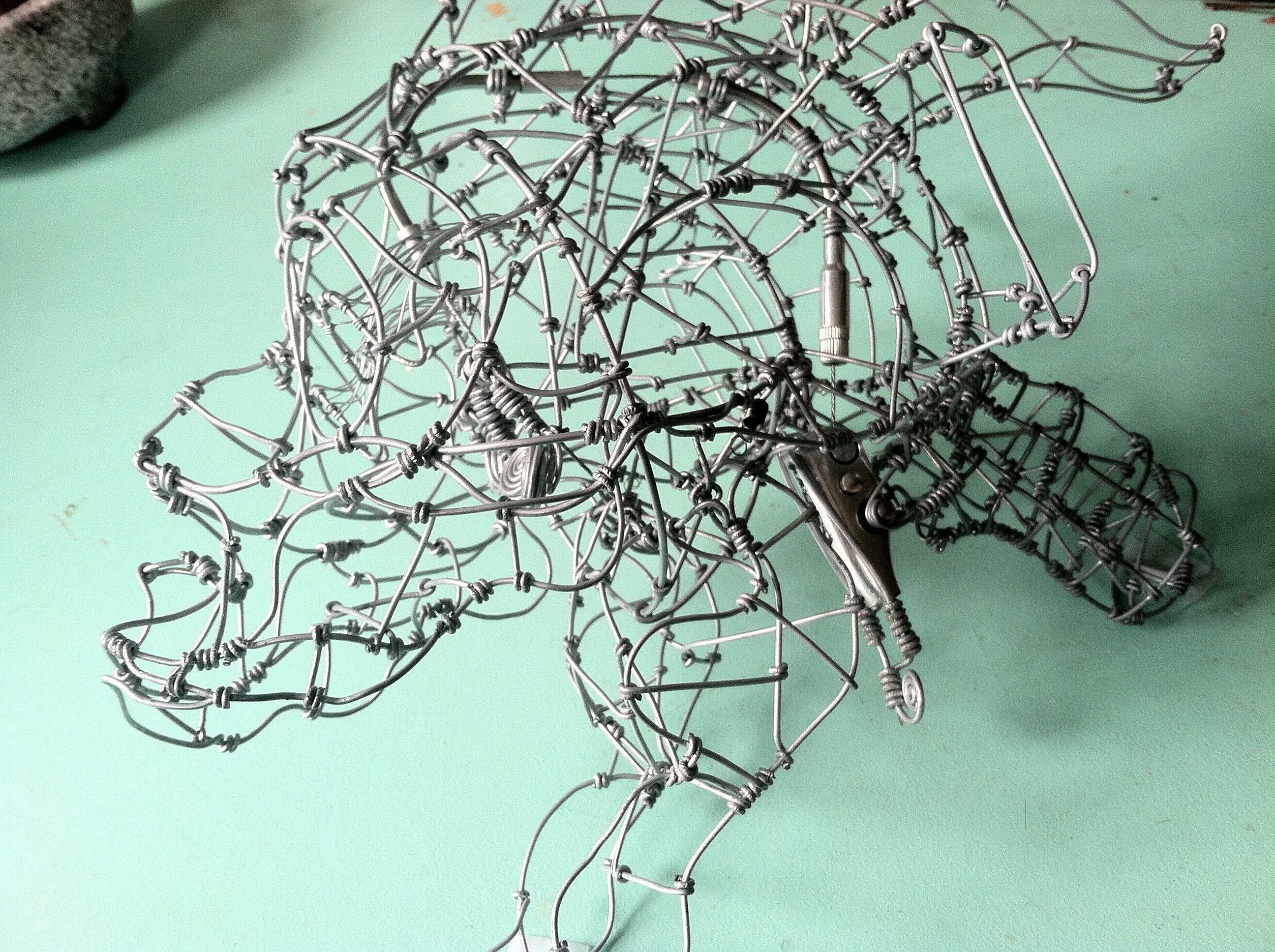 wire sculpture with bike lever action (pretty hard to photograph ...