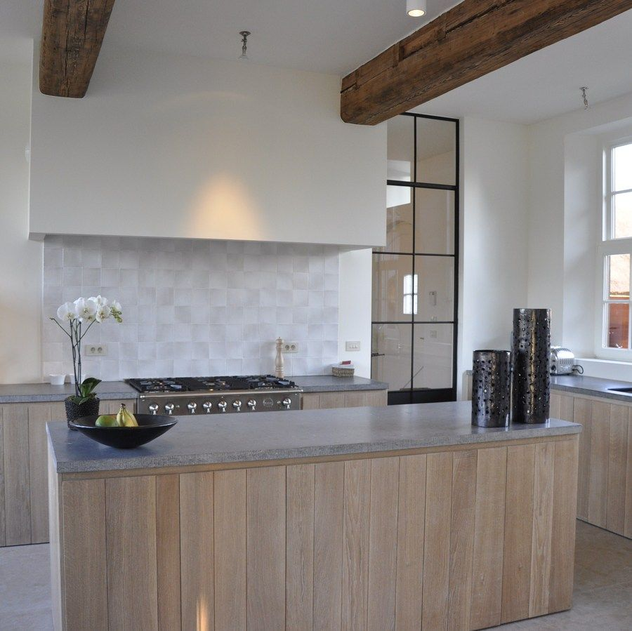 White washed cabinets concrete counter tops white walls with dark