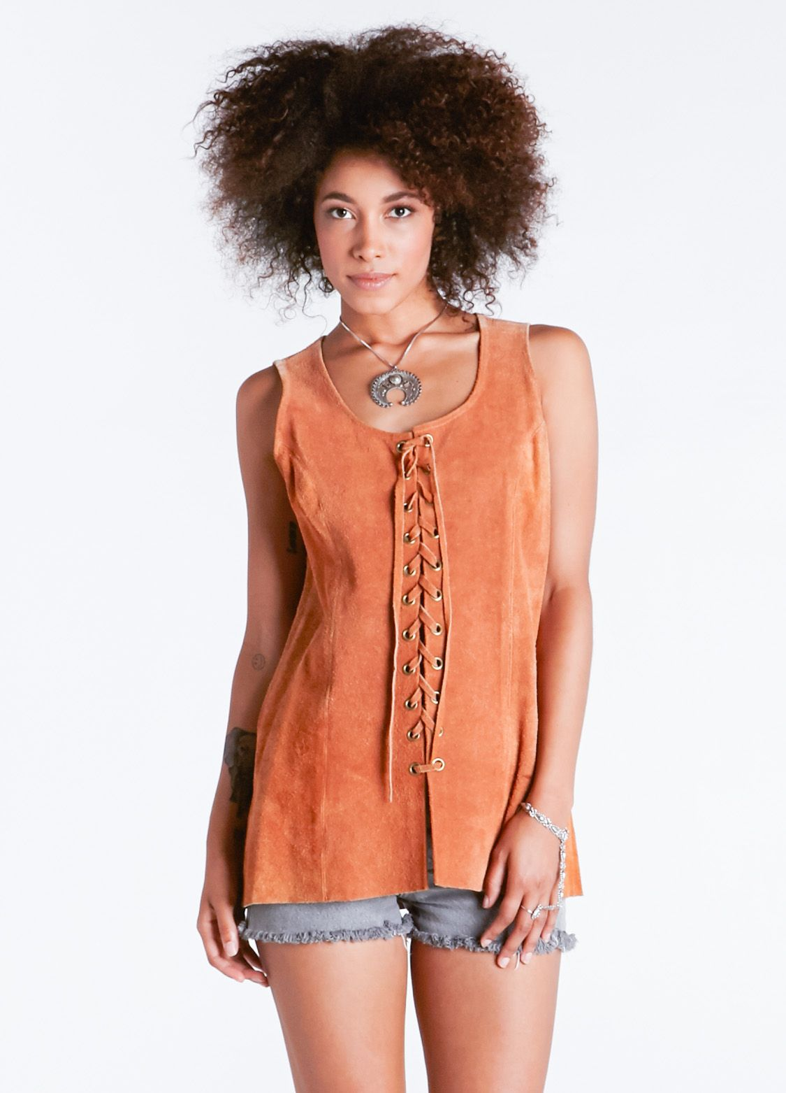 Awesome 70s era suede top featuring front lace up closure  Condition: Good Marked Size: 13/14 Color: Tan Fabric Suede  Bust:34'' Waist: 32'' Length: 28''