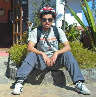 Our Team Leaders Bishnu Relaxing After 4 Hours Uphill Ride To Nagarkot Day Tours Kathmandu Valley Kathmandu