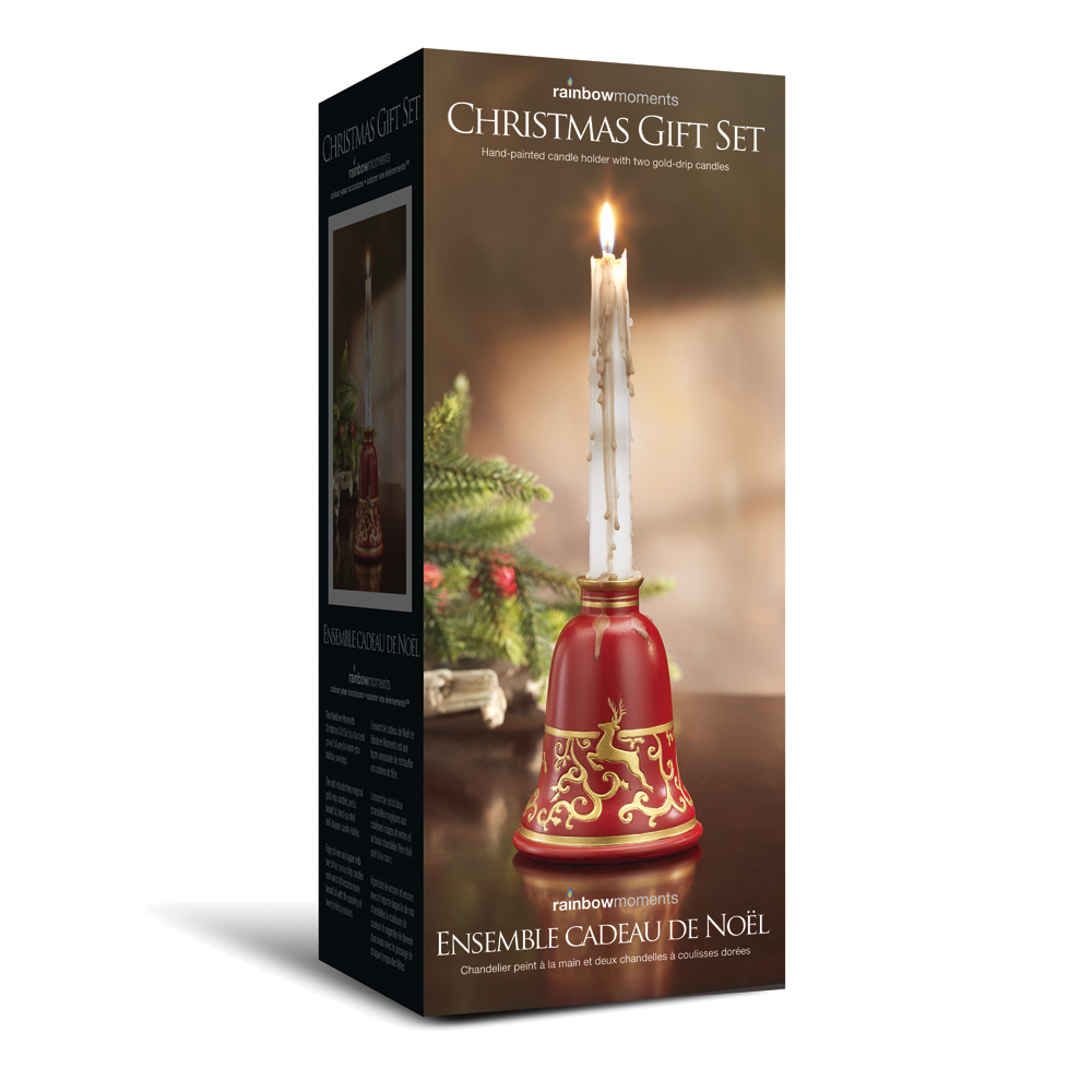 Rainbow Moments Christmas bell drip candle set. Includes bell-shaped candle holder as well as one candle in white, that drips gold when lit. Makes an excellent holiday centerpiece as well as an excellent gift idea!