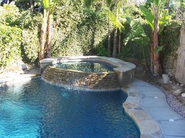 Pools - tropical - Pool - Other Metro - Bluewater Construction Group Inc.   Lights in pool deck ground