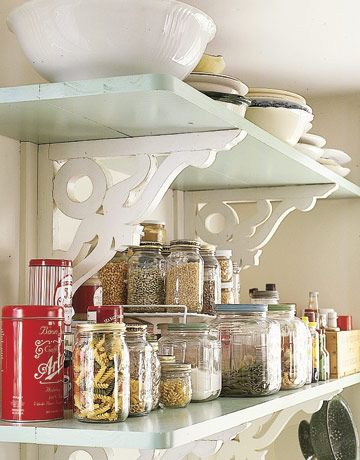 Open Storage-Vintage brackets dress up the look. Simple shelves make dishes and other unique items the focal point. Vintage brackets dress up the look.