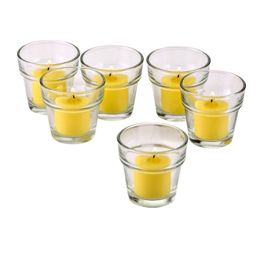 Clear glass flower pot votive candle holders with yellow votive