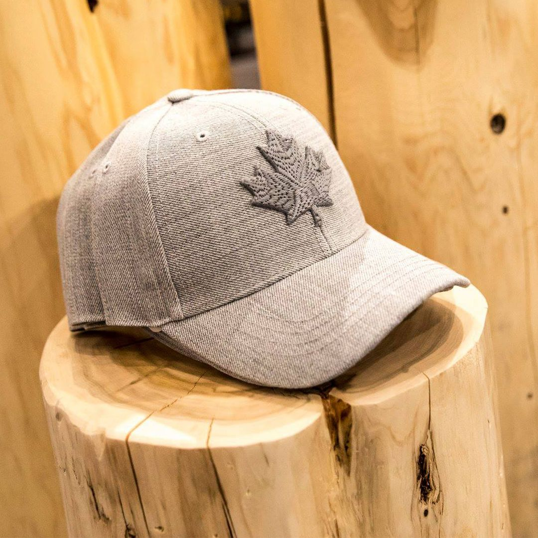 cfaadfc9df0df Show off your Canadian pride with our Mens Modern Leaf Baseball Cap