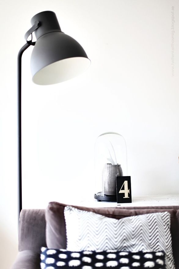 IKEA hektar lamp next to the lounge in the room to read a