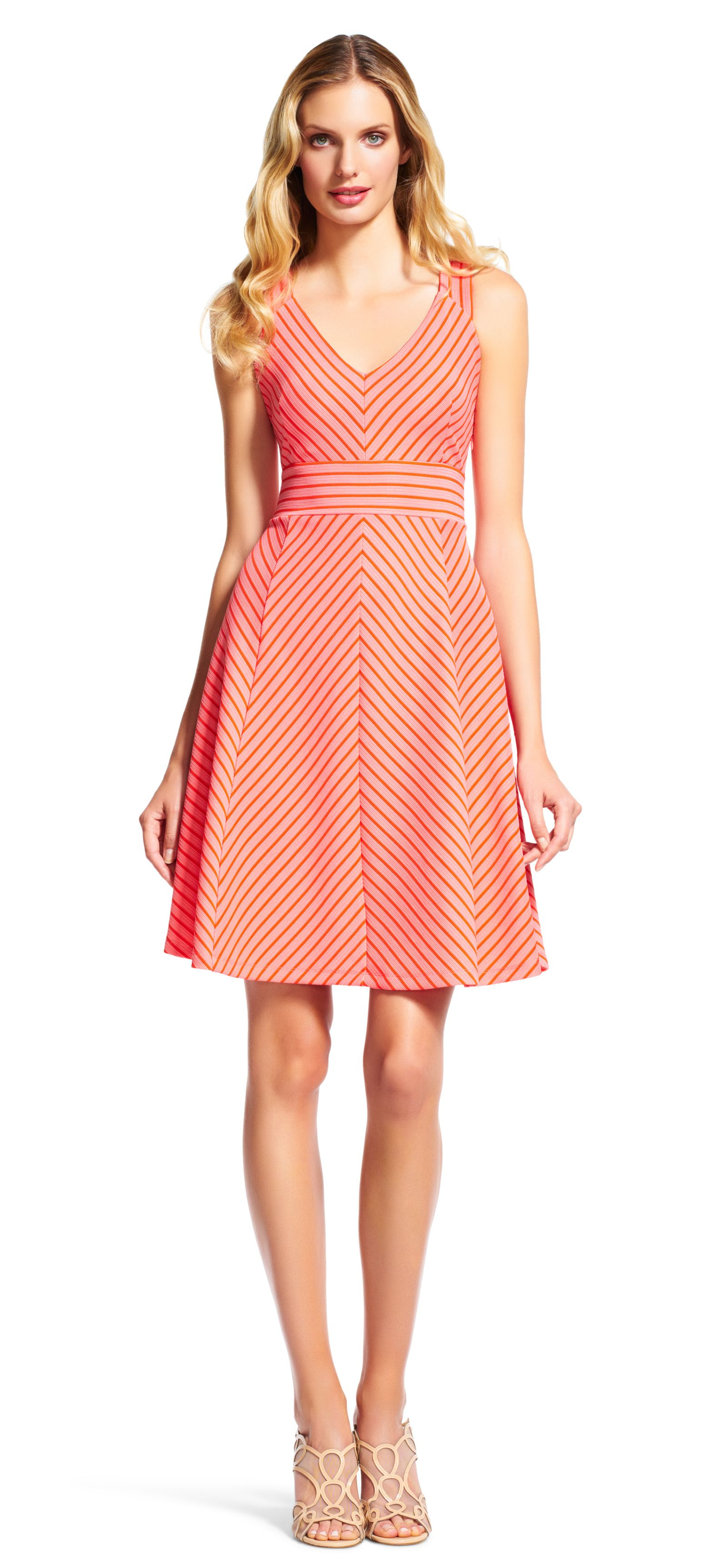 Adrianna Papell sleeveless striped fit and flare dress   Bright and feminine, this pretty day dress is a must for summer. A contrast stripe print covers this fit and flare dress featuring a v-neckline and criss-cross back. The a-line skirt adds extra flounce to this short dress.
