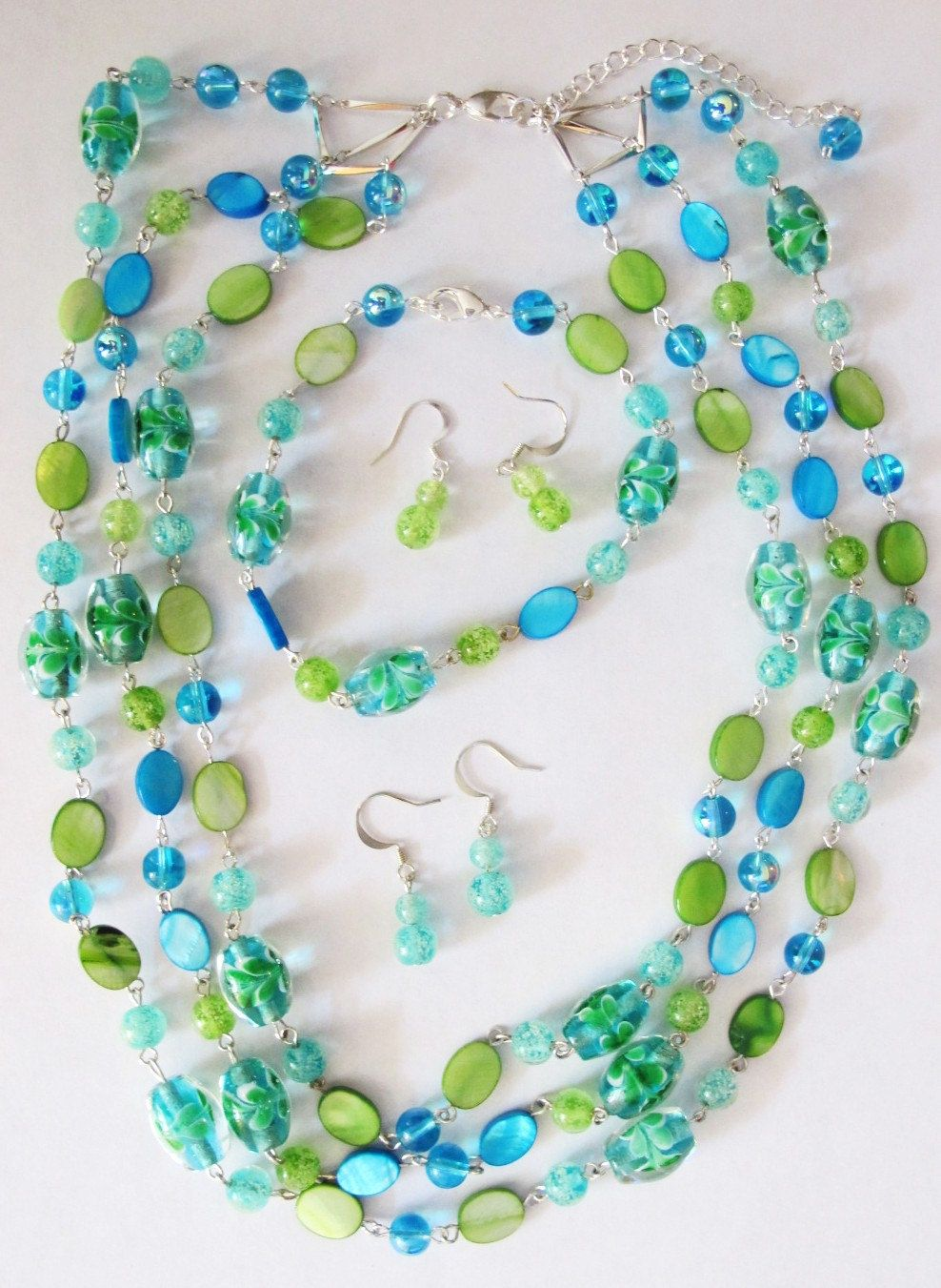 Stylish, glow-in-the-dark blue and green glass bead necklace, bracelet, duel earring set. by Julesdimension on Etsy