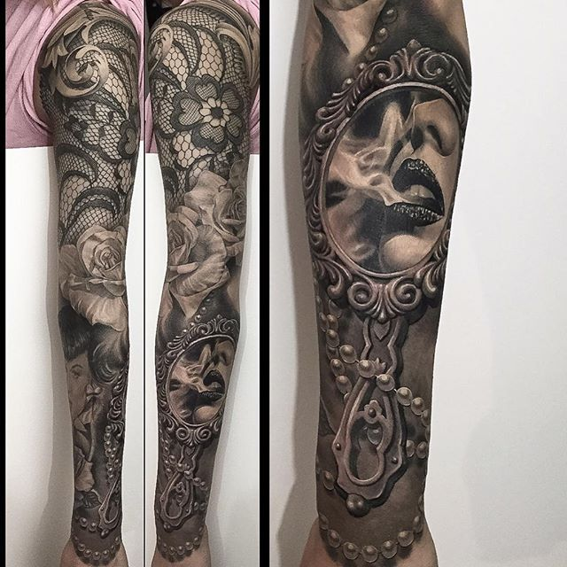 Black and grey sleeve with floral lace, pearls, portrait of woman smoking. Done by Greg Nicholson of Insanity Ink team (BC, Canada)
