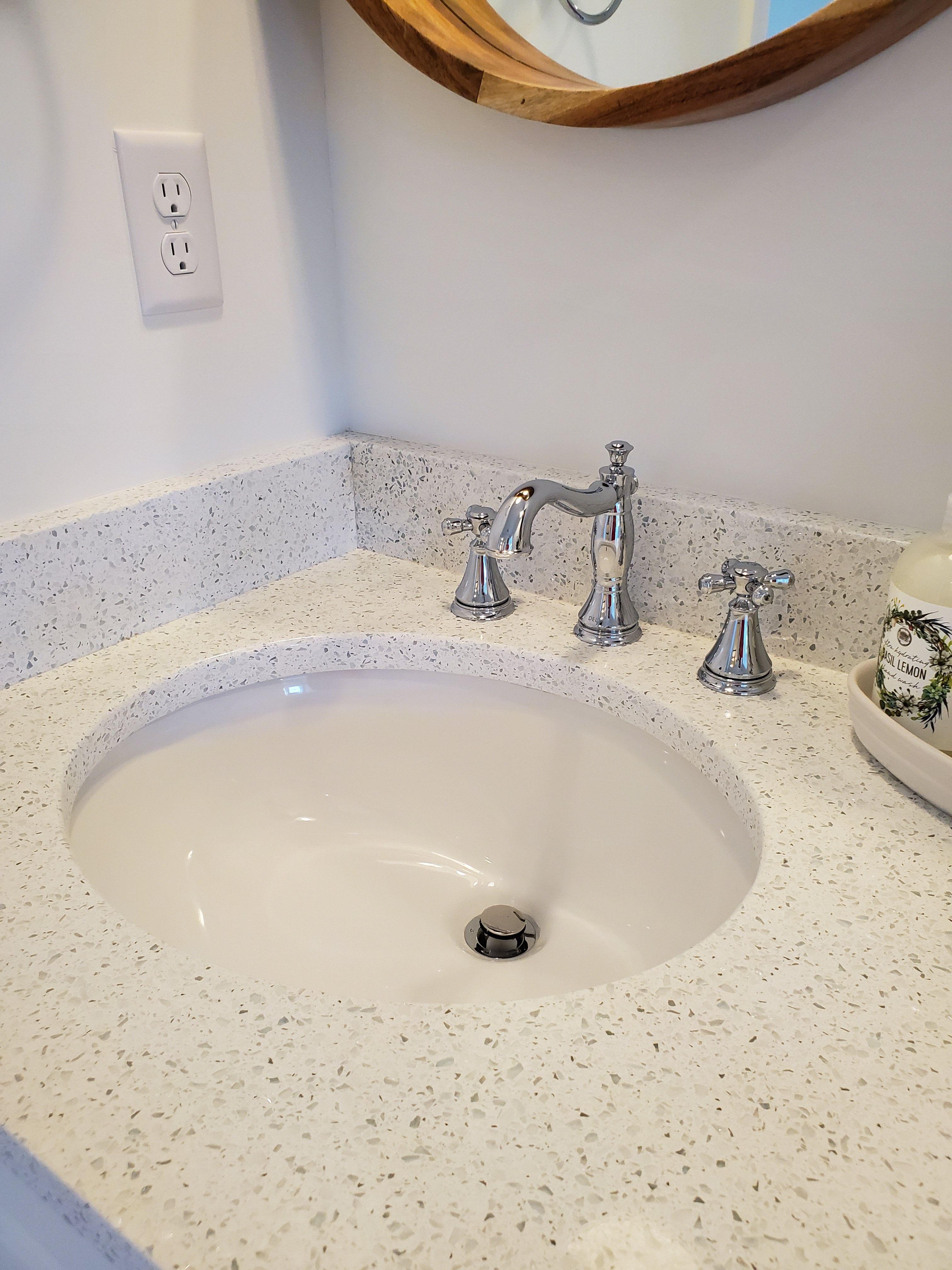 White porcelain undermount bathroom sink with granite ...