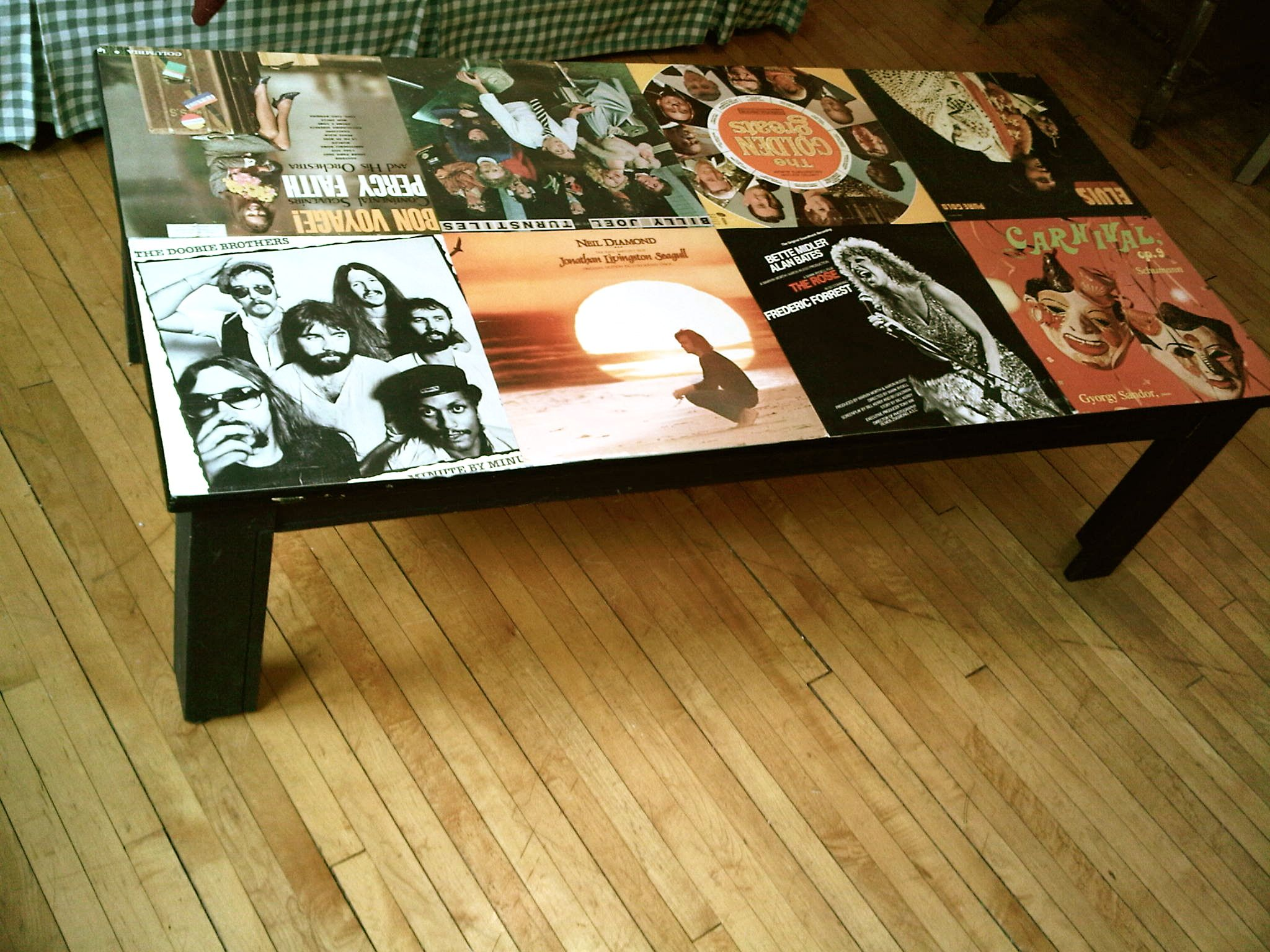 I mod podged my coffee table with old record covers