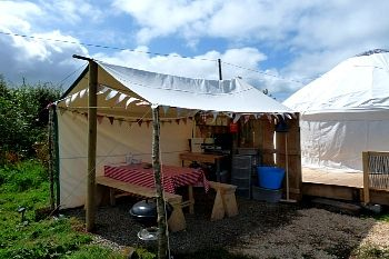 Cosy and comfy yurt camping on a family-run eco-site just one mile from the Pembrokeshire Coastal Path in Wales