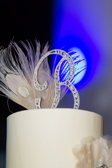 feather wedding cake toppers bling monogram and peacock feather cake topper wbr 14222