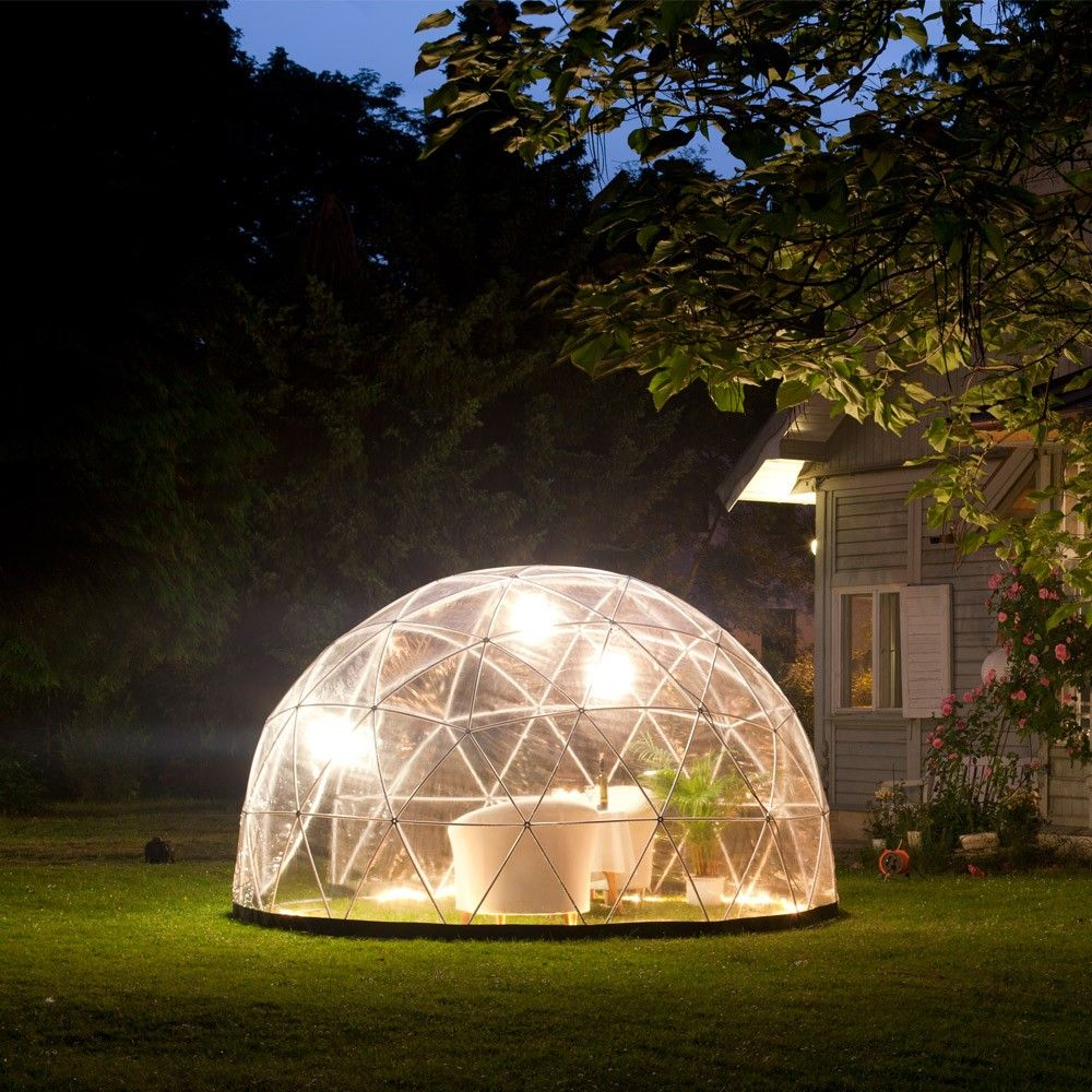this stylish clear geodesic dome is designed as a winter garden or