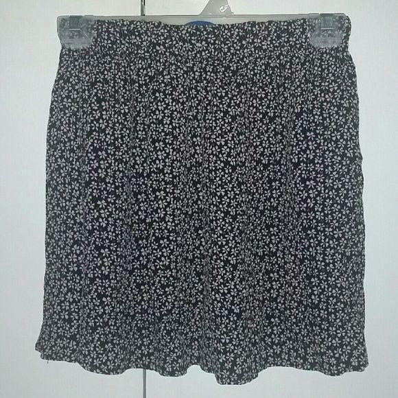 Brandy Melville floral skirt I think it's the heather? Definitely longer than the luma. Rayon material. Brandy Melville Skirts Mini