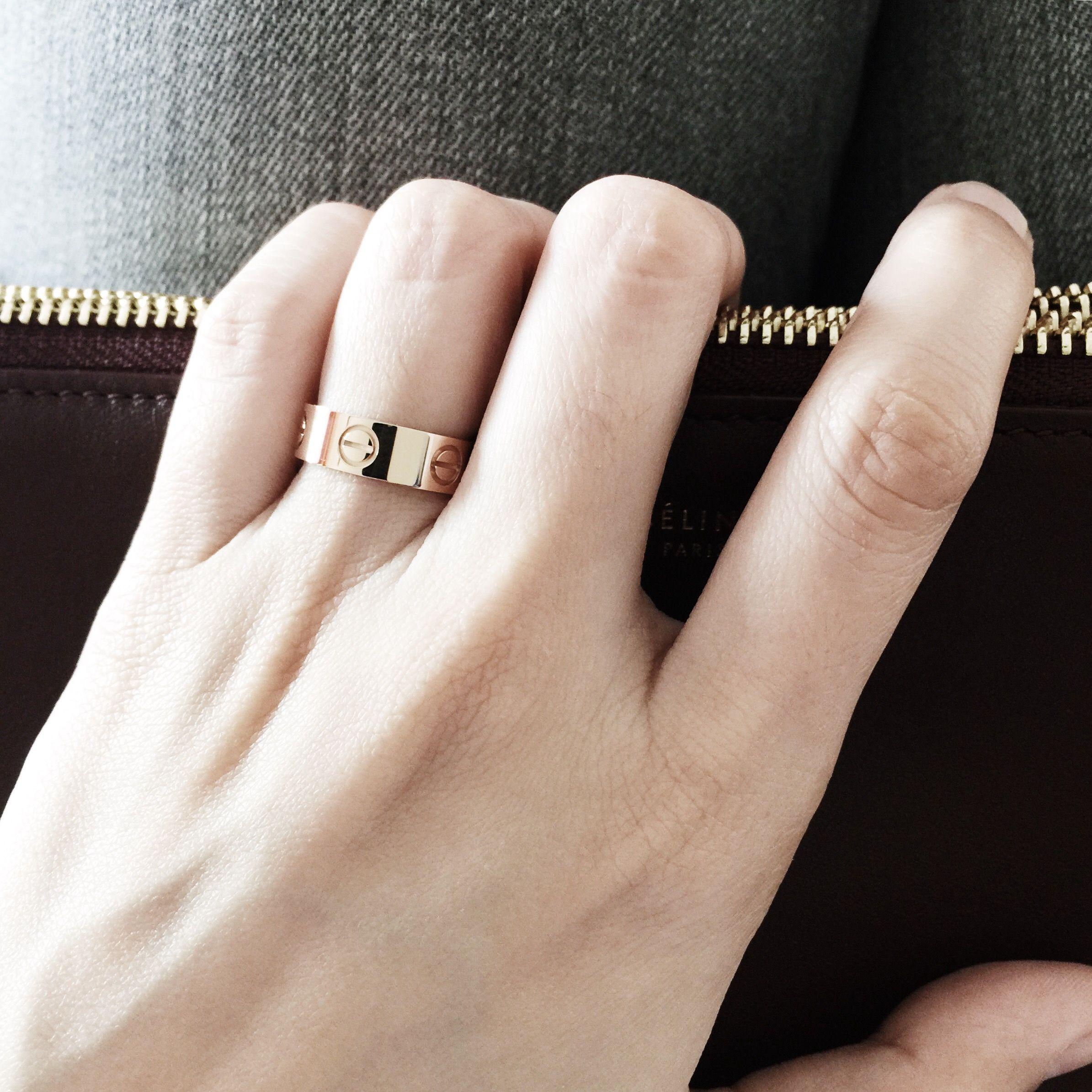 Cartier Love Ring rose gold on a Celine Trio burgundy