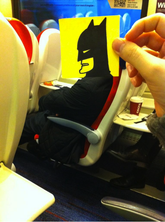 (this artist spends his train commute drawing funny drawings that replace his fellow commuters' heads)