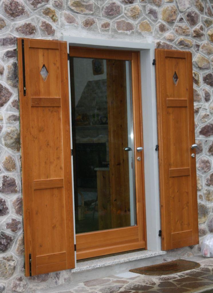 porta ingresso in legno di larice con scuro decorato - centurioni ... - Legno Di Teak Porta Dingresso Di Fusione