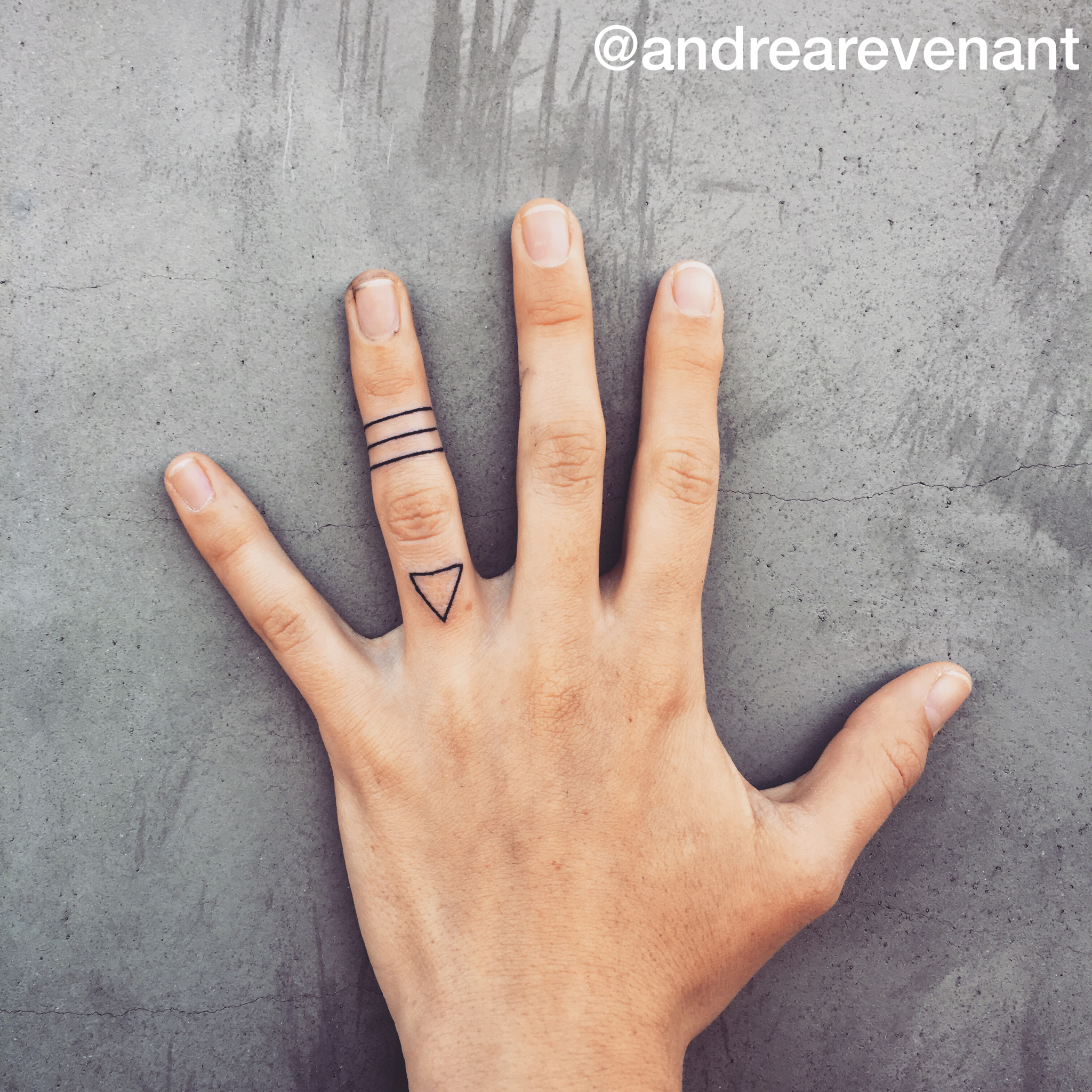 Simple lines and triangle finger tattoos by Andrea