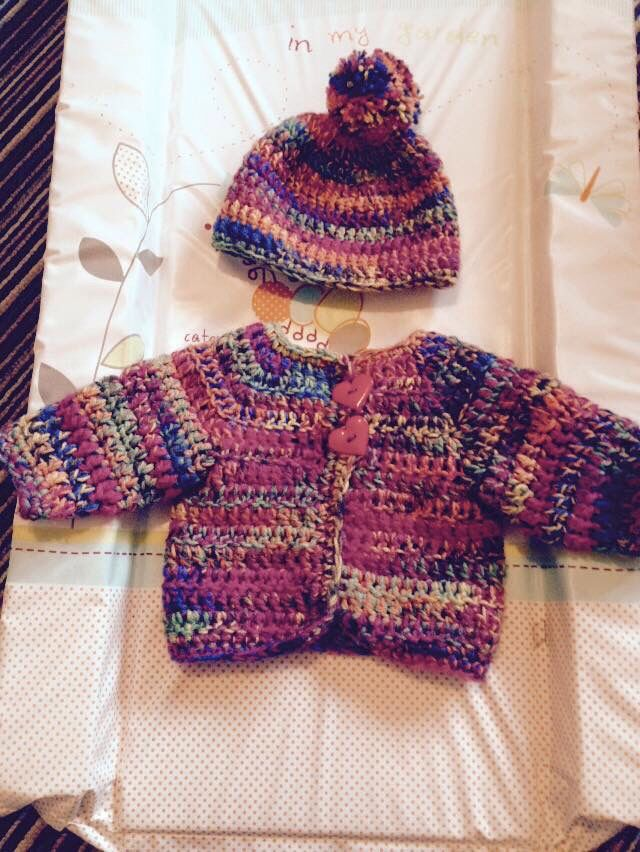 I don't think we'll be losing her anytime soon! Bobble hat and cardi set.