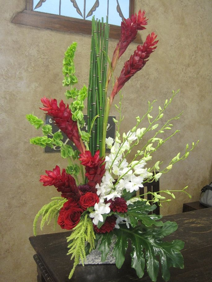 Tropical floral arangements red ginger white orchids
