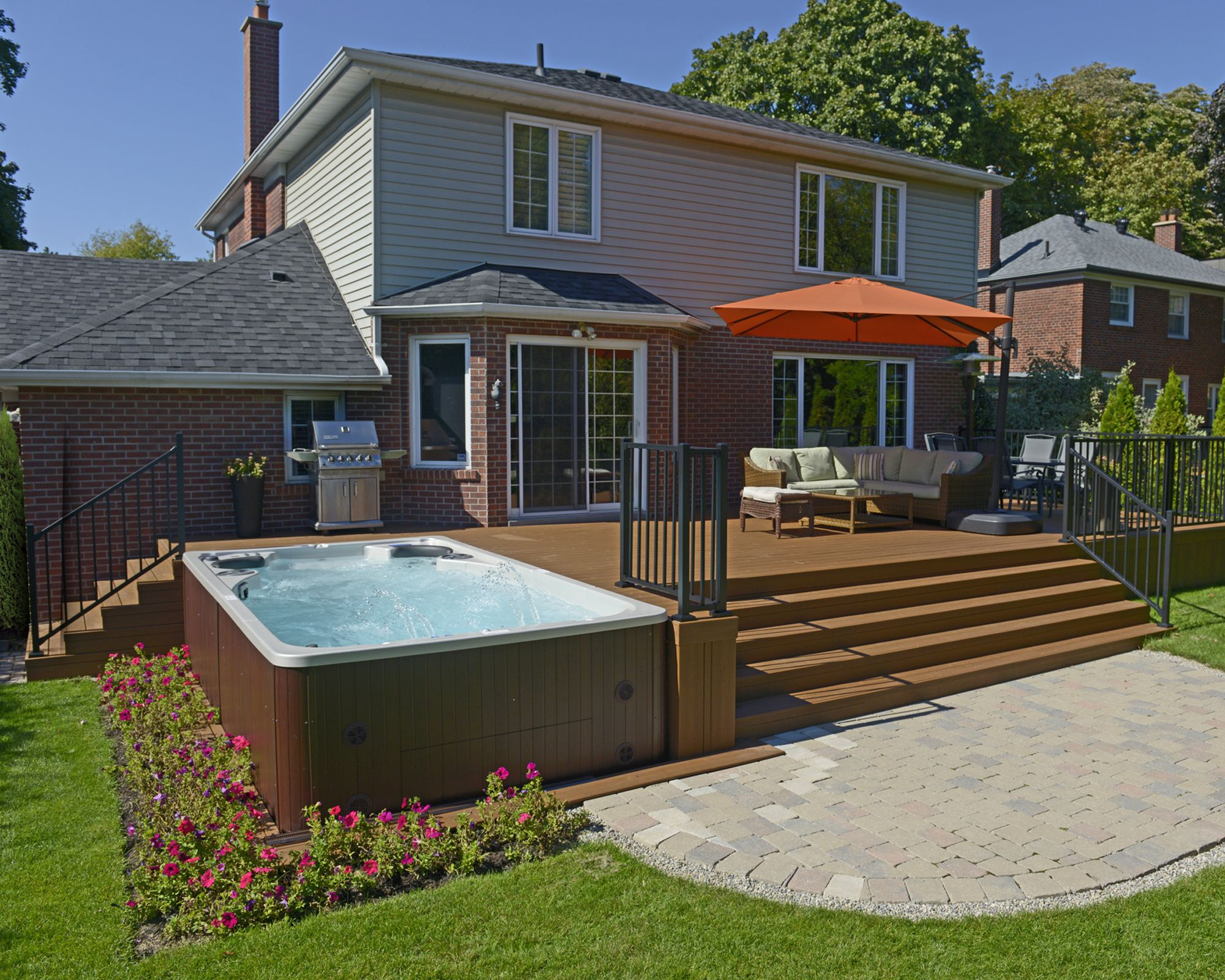 Swim Spa Backyard Designs hydropool self cleaning swim spa installed next to a deck | pools in