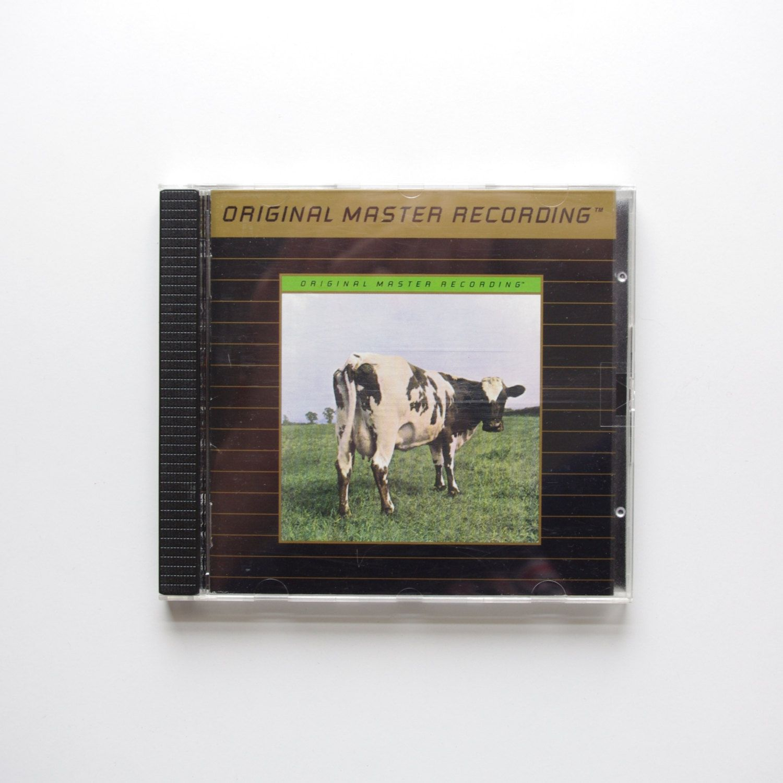 Pink Floyd - Atom Heart Mother - 24k Gold Ultradisc II CD - UDCD 595 by ThisCharmingManCave on Etsy  https://www.etsy.com/listing/232303444/pink-floyd-atom-heart-mother-24k-gold
