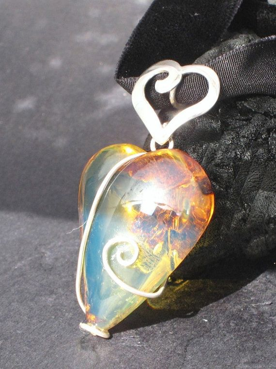 Blue amber pendant, Venom of Love - catchy minty natural Dominican amber heart. $399.00, via Etsy.