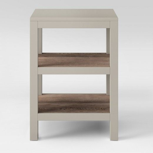 Rustic style gets a sleek, modern update with this Hadley Accent Table with Shelves from Threshold??. This versatile accent table features two shelves with a rustic, distressed wood finish paired with a neutral-colored painted flat top and frame. The clean lines and sleek design of this accent table with multiple shelves allow it to fit seamlessly into any room with a modern aesthetic. You can use this modern accent table in your living room, family room or home office for functionality and…