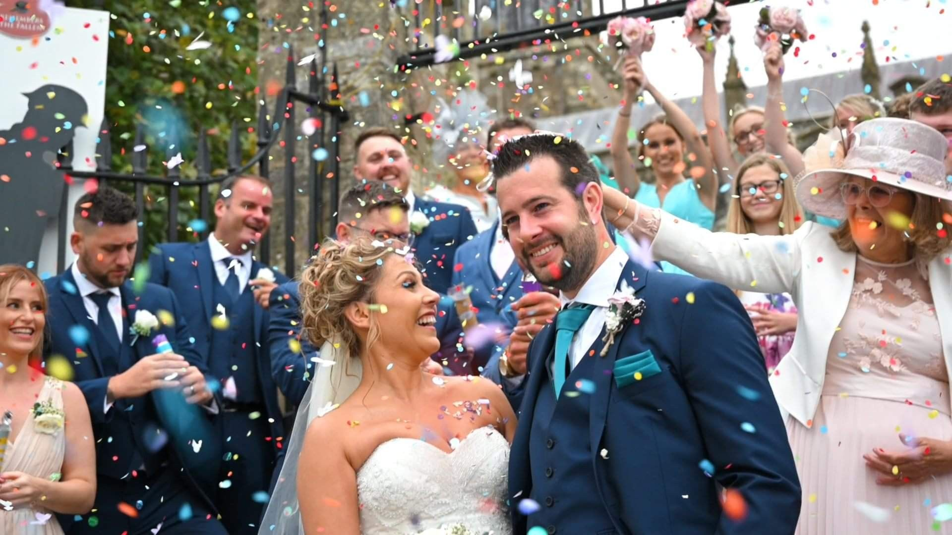A couple stood on the steps of the church on their wedding day surrounded by confetti