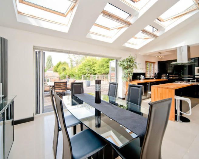 Photo Of Open Plan Velux Dining Room Kitchen With Sliding Folding Doors Skylights Windows And