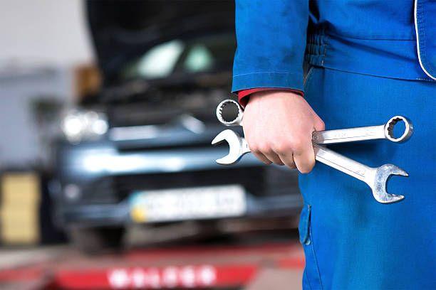 Hand Of Car Mechanic With Wrench Auto Repair Garage Scream