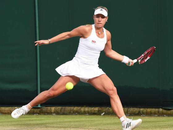 Tennis-Nach-Regen-in-Wimbledon-Kerber-weiter-Petkovic-raus_image_630_420f.jpg (560×420)