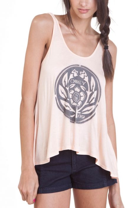 Obey Flower Power Stencil Tank.  Fight for peace in the OBEY Flower Power Stencil tank top. Fitted through the bodice with a flared, flowing hemline. Star Face logo sets of the floral crest stencil screenprint. Lightweight rayon blend features a touch of stretch for a resilient, drapey finish. Sleeveless tank top. Scoop neck. Deep scoop back. Hemline drops at back.