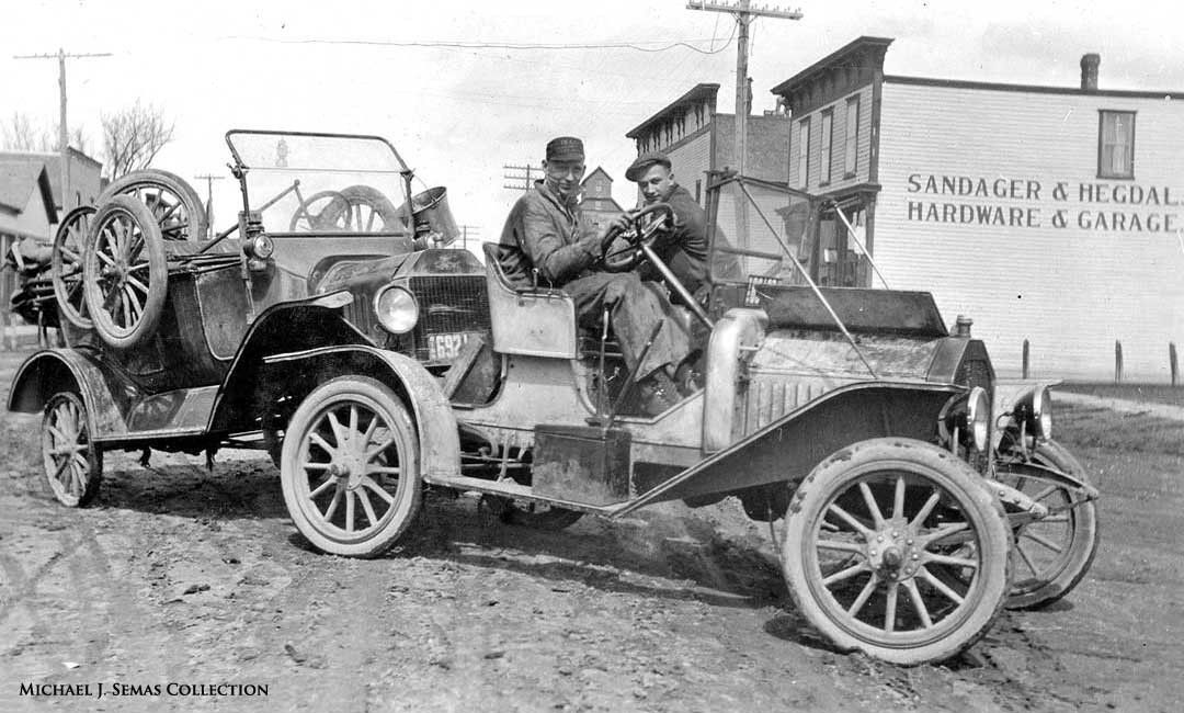 Model T Ford and Mystery car in Minnesota in the teens   Top down ...