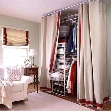 2ecac1de7f9 Hide Storage Behind a Curtain If adding an armoire to your bedroom isn t  enough for your clothing collection