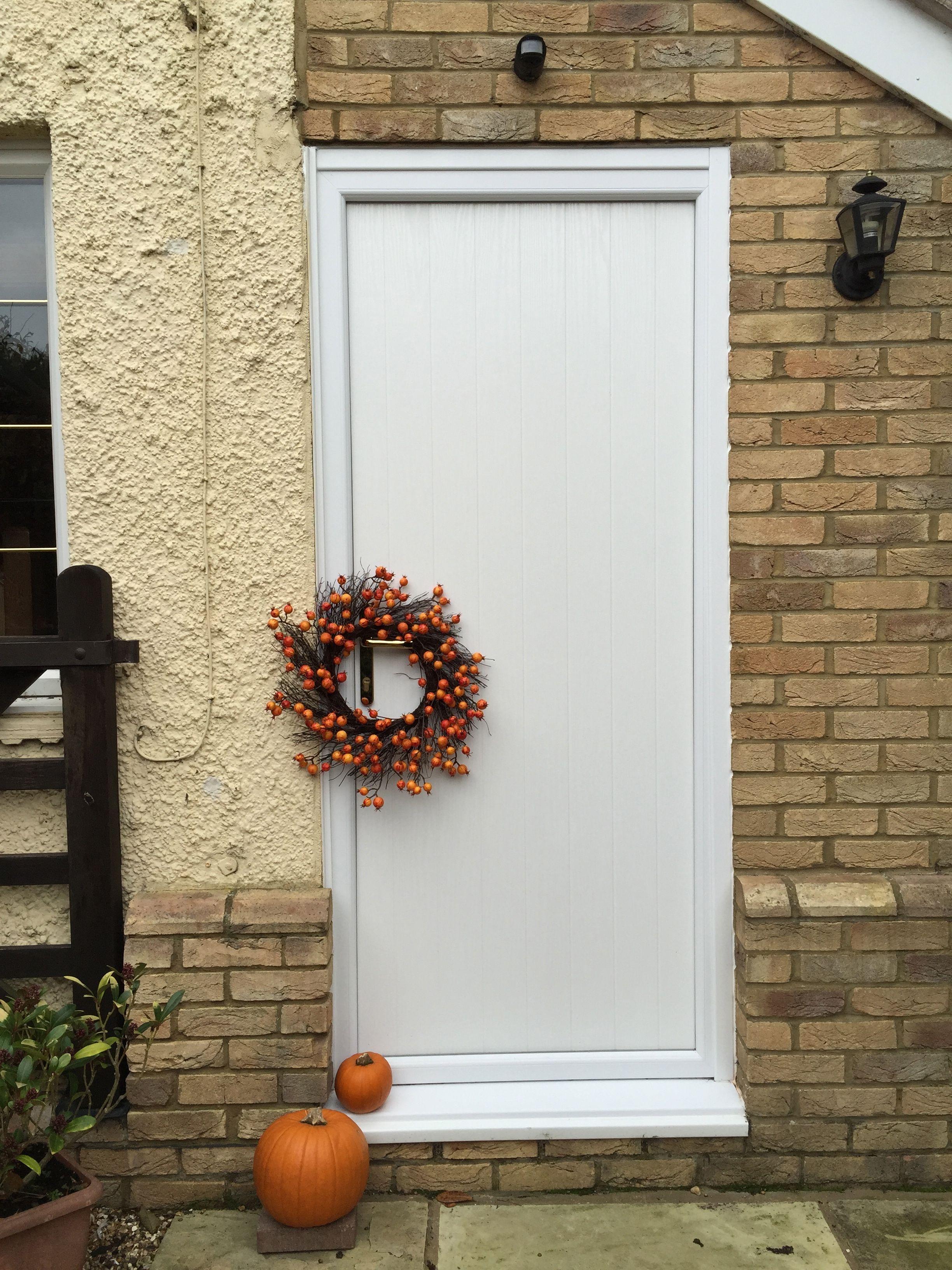 Halloween Decor Looks Stunning Against White Composite Door