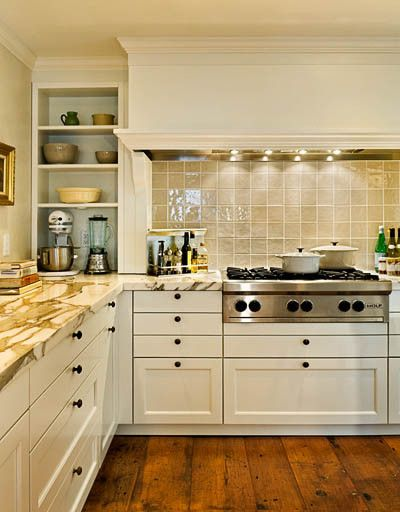 White shaker style cabinets busy marble counter glass tile backsplash behind stove might be nice gray distressed wide plank wood floor also