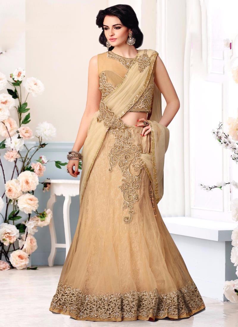 Peach color saree for wedding sumptuous patch border work net lehenga saree  net sarees