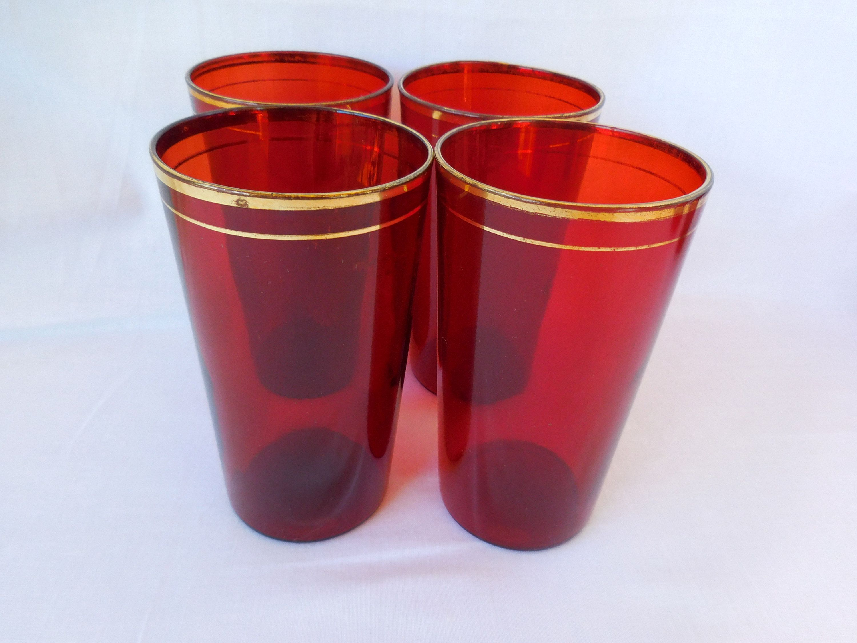 Vintage red ruby color drinking glasses with gold rim set of four mid century by vintagefindsbyruby on etsy