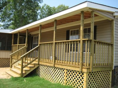 Covered Front Porch Wood Deck With Stairs And Lattice Skirting