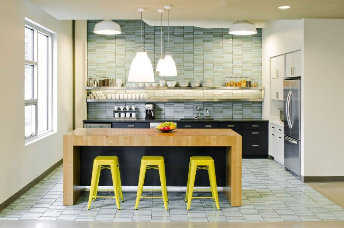 Yellow tolix stools at wood counter. New art nook off kitchen ...