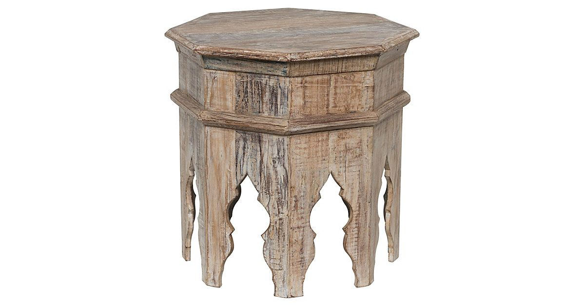 Hand-carved of reclaimed wood and finished with a distressed white stain, this octagonal side table impresses guests with its masterful craftsmanship and rugged, natural allure. Due to the handmade...