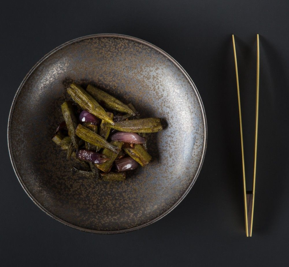 Crescent Brass Pincers, a serving and plating tool by Eatingtools in collaboration with metalsmith Erica Moody and designer Laura Rittenhouse.