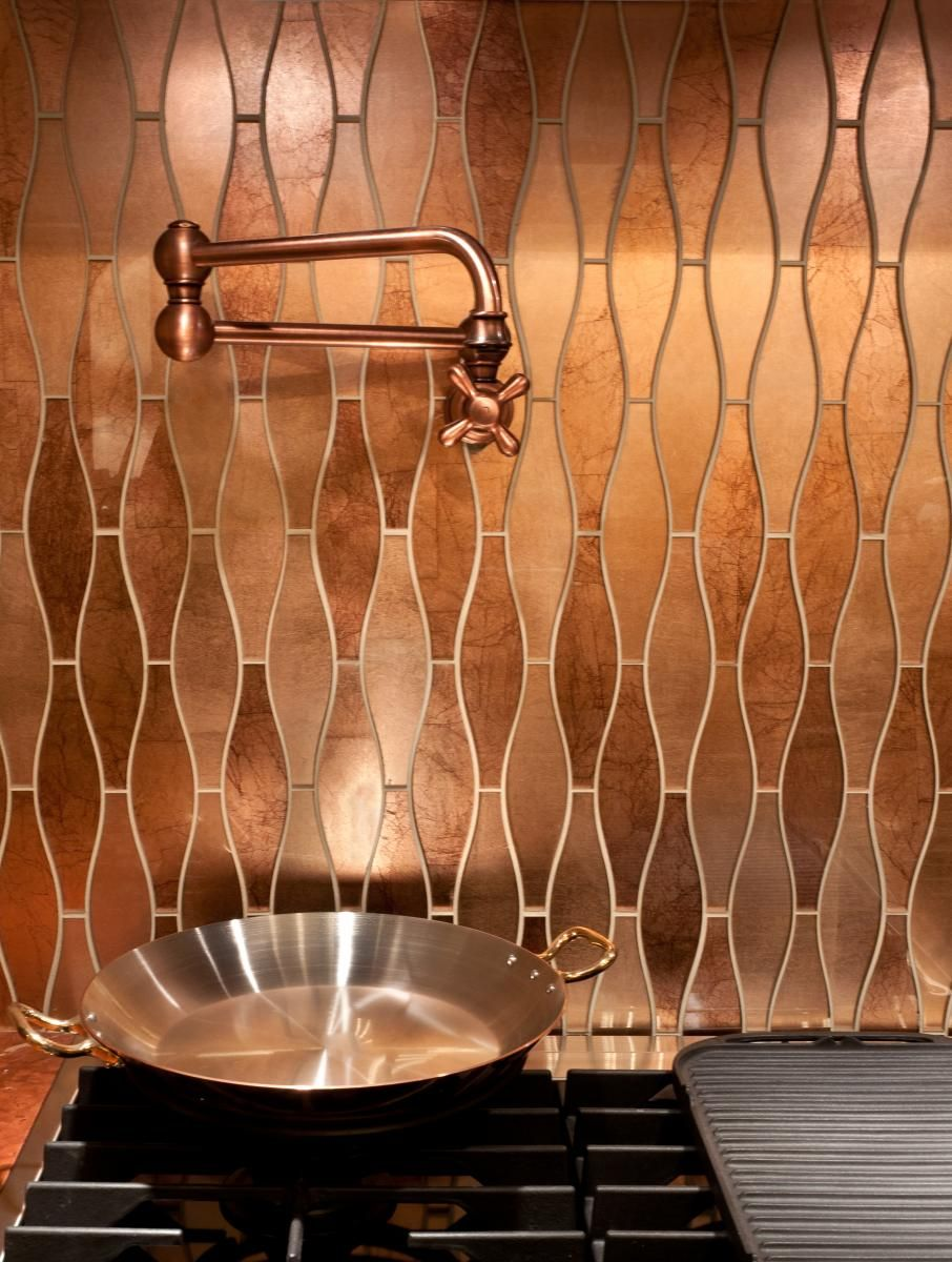 Copper backsplash tile in kitchen